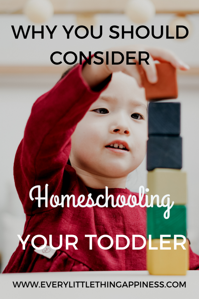 A toddler playing with multi color blocks and the text mentioning why you should consider Homeschooling your toddler. Read on www.everylittlethinghappiness.com